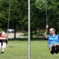 Emily Mason, 2, takes a ride on a swing with her dad, Joseph Mason of Fayetteville, at North Shore P...