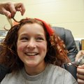 Kendall Yarbrough, 10, has her hair curled and colored by Lesa Owens, left, and classmate Skyler Owe...