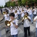 The Fayetteville High School Bulldog Marching Band makes their way around the downtown square Wednes...
