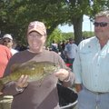 Tammy Duncan of Lowell beams over a 3.1-pound smallmouth bass she and her husband, Eugene Duncan, ca...