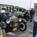 Delbert Hall of Siloam Springs looks over a Ford Model T on Wednesday at Frisco Park in Rogers. The ...