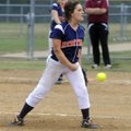 Rogers Heritage's Jessica Vazquez pitches against Springdale High on Tuesday at J.B. Hunt Park in Sp...
