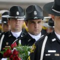 Cpl. Jason Renfrow, center, waits Wednesday with members of Springdale Police Department's Honor Gua...