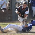 Rogers Heritage's Spanky Purdy tries to tag Rogers High's Alex Shelor on May 6. Shelor was called sa...