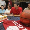 Greenland's Elijah Wolfe, center, signs a national letter of intent to play basketball for Lyon Col...