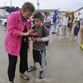 Rhonda Moore, principal at Root Elementary School in Fayetteville helps a student call a parent aft...