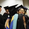 Jori McCleland, right, hugs Debbie Diehm on Thursday before entering the Shiloh Christian's graduat...