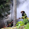 HOUSE FIRE - Firefighters drag hoses Friday across steep terrain to a house fire at 9391 Suits Us Dr...