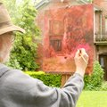 DAUNTLESS DAUBS - M.M. Kent from Fayetteville paints his interpretation Friday of the entrance to th...