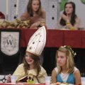 MIDDLE AGE - Sarah Anne Shipley, left, and Maci Beth Ecklund participate in a medieval feast Friday ...