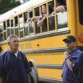 Fayetteville coach Jason Shirey, right, and assistant coach Chuck Brookshire speak as members of the...