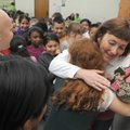 TEACHER OF THE YEAR - Terri Johnson is congratulated Friday by her third-grade class after she recei...