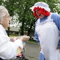 NURSING HOME PARADE - Deb Davies, right, visits with Ruby Snow, 96, during a parade celebrating Nati...