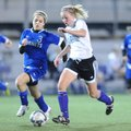 Fayetteville junior Anne Mitchell, center, dribbles the ball as Bryant junior Sarenity Gomez defends...