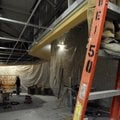 Contractors work on the new deli area Tuesday at Walmart Neighborhood Market in Bentonville.