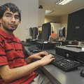 Karan Batra, a senior at Bentonville High School, photographed in one of the school's computer labs....