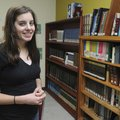 Claire Marie Poteet stands in the library at Ambassadors for Christ Academy in Bentonville. Poteet p...