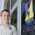 Haas Hall Academy senior Matthew Heckmann stands in front of the Fayetteville school.  Heckman is pl...