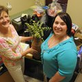Rhonda Woodruff, left, and Stephanie Huy, both volunteers for the Saturday Spring Fling fundraiser f...