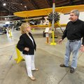 Warren Jones, director of the Arkansas Air Museum, speaks with event chairwoman Nancy Young on Tuesd...