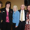 Arkansas first lady Ginger Beebe, center, is joined at Butterflies and Blooms by Saving Grace founde...