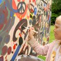 MAKING HER MARK - Kiara Wright, 7, adds her artwork Saturday to a panel during a fundraiser for the ...