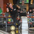 Mark Williams, of Beaumont, Texas, bowls Sunday while warming up for the finals of the NW Arkansas O...