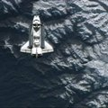 FILE — The space shuttle Atlantis flies over a mountainous region of Earth before docking at the int...