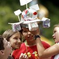 Grimes Elementary School fourth-graders Cole Regier (cq) (from left), Alyssa Danley, Alexis Villalo...