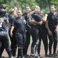 The Bentonville softball team celebrates its 3-2 win over Russelville on Monday during the Class 7A ...