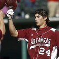 Arkansas' Brett Eibner, who hit a pair of doubles and scored a run at the plate in a 5-2 loss Tuesda...