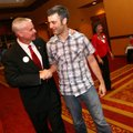 Steve Womack talks to Jonathan Story before he played piano at Womack's watch party on election nigh...