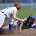 Fayetteville's Camie Bales is tagged out by North Little Rock's Skylar Howard during a stolen base a...