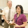 Kirksey Middle School teacher Cathy Julius accepts the Rogers-Lowell Chamber of Commerce's Middle Sc...