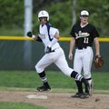 Shiloh Christian's Chris Oliver rounds second base as De Queen's Sam Willis looks in shock at an ove...