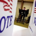 Marie Chandler of Bentonville votes in the 34th precinct in the non-presidential primaries Tuesday a...