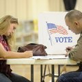 Kevin and Melissa Guthrie of Fayetteville, cast their ballot Tuesday afternoon at the Yvonne Richard...