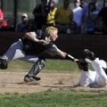 Prairie Grove catcher Dakota Daniels, left, reaches out to tag Shiloh Christian's Josh Salsbury at t...