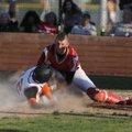Farmington catcher Trey Spencer, right, tags out Malvern's Jon Whit Golden at the plate in the first...