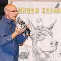 Author Gordon Korman speaks Tuesday to seventh- and eighth-graders in the Little Theater at Lincoln ...