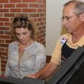 Jenny Miller is assisted Tuesday by election clerk Dan Malek in Precinct 32 at First Presbyterian Ch...