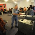 Election worker Donnie Morgan assists voters Tuesday at Farmington Baptist Church. Voters were lined...