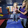 Christie Summerford, a physical therapist for Children's Therapy T.E.A.M. in Fayetteville works with...