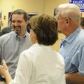 Kelley Cradduck, left, talks with supporters Charlie Holyfield, right, and Holly Holyfield at a elec...