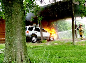 "Flames engulfing the 2004 Ford Escape reached toward the ceiling of the carport of the home of Orville and Maureen Haas at 3540 Hayden Road. Smoke billowed into the sky. Pea Ridge firefighters arrived on the scene shortly after noon Monday. Firefighter John Bobholz quickly extinguished the flames as other firefighters manned the pump and checked the house for signs of fire. The vehicle was destroyed but the home was saved. ""You are a blessing,"" Mrs. Haas told the firefighters.