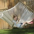 Marley Hudspeth, 7 of Fayetteville, enjoys an after school snack as she relaxes in a backyard hamm...