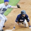 Northwest Arkansas' Nick Van Stratten safely slides back to first base before Tulsa's Kiel Roling, l...