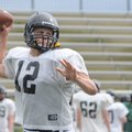 Bentonville's Pearson Gean throws a pass Wednesday during spring practice in Tiger Stadium.
