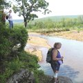 Tracy Fortuny of Rogers, left, and Debbie Van Blaricom of Springdale admire the view of Frog Bayou w...