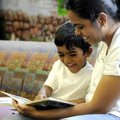 Gowri Venkatesane reads on Wednesday to her son, Aarya, 3, at the Rogers Public Library. Venkatesane...